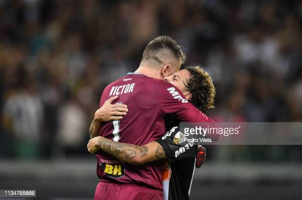 Victor and Guga of Atletico MG celebrate a scored goal against Zamora during a match between Atletico MG and Zamora as part of Copa CONMEBOL...