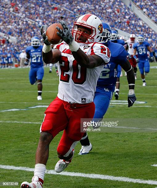 Victor Anderson of the Louisville Cardinals reaches out to catch a pass during the game against the Kentucky Wildcats at Commonwealth Stadium on...