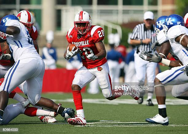 Victor Anderson of the Louisville Cardinals runs with the ball during the game against the Kentucky Wildcats at Papa John's Cardinal Stadium on...