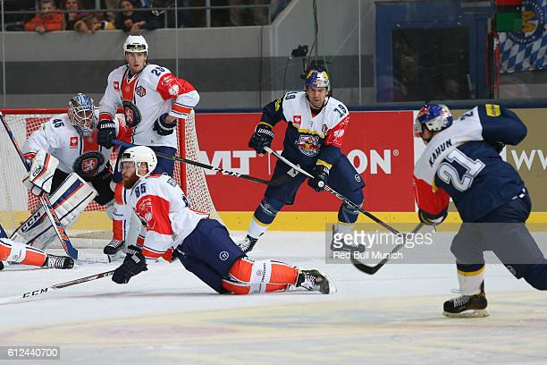 Victor Andren, Liam Reddox of Vaxjo, Jonathan Matsumoto and Dominik Kahun of Munich during the Champions Hockey League Round of 32 match between Red...