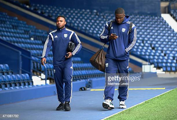 Victor Anichebe and Stéphane Sessegnon of West Brom arrive prior to the Barclays Premier League match between West Bromwich Albion and Liverpool at...