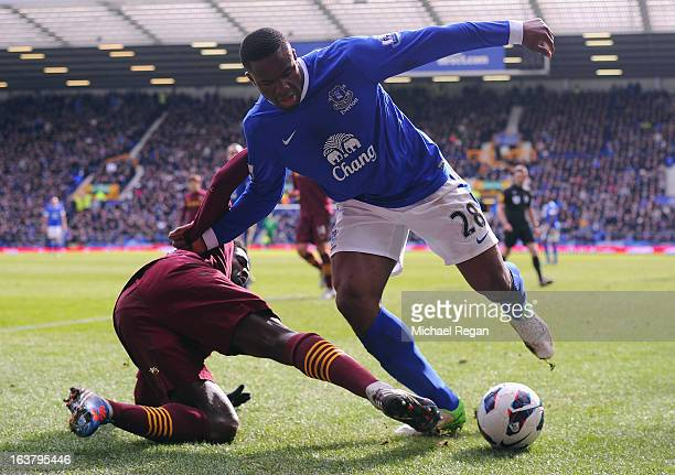 Victor Anichebe of Everton competes with Kolo Toure of Manchester City during the Barclays Premier League match between Everton and Manchester City...