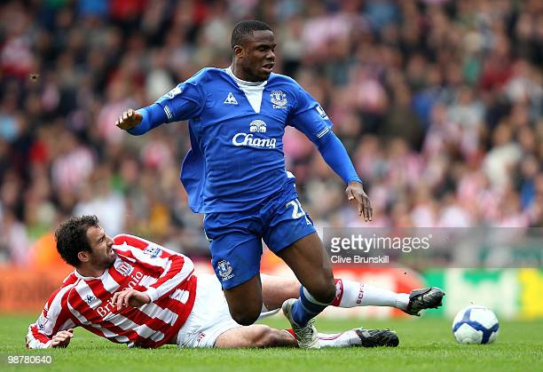 Victor Anichebe of Everton is tackled by Danny Higginbotham of Stoke City during the Barclays Premier League match between Stoke City and Everton at...
