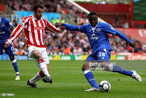 Victor Anichebe of Everton lines up a shot at goal as Danny Higginbotham of Stoke City trys to intercept during the Barclays Premier League match...