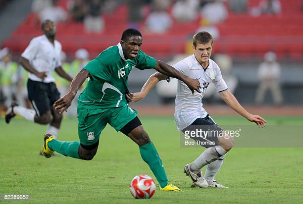 Victor Anichebe of Nigeria clashes with Robbie Rogers of the United States during the Men's First Round Group B match between Nigeria and the United...