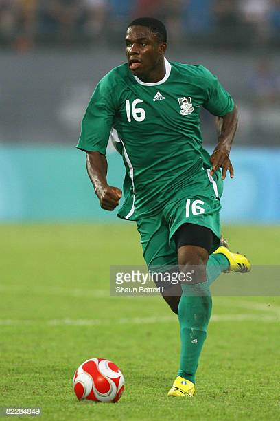 Victor Anichebe of Nigeria runs with the ball during the Men's First Round Group B match against the United States at the Workers' Stadium on Day 5...