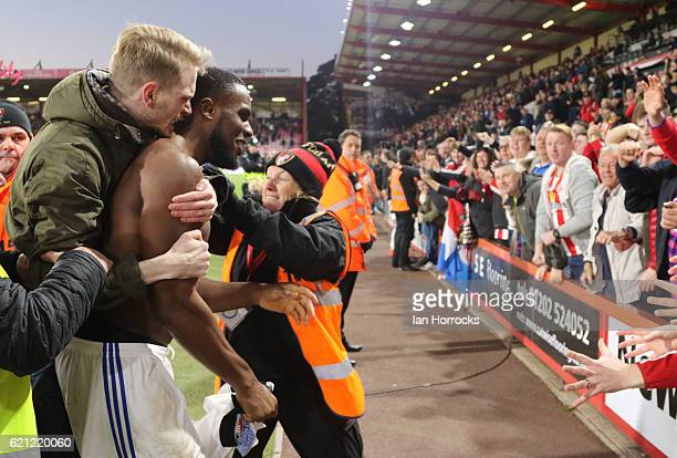 Victor Anichebe of Sunderland celebrates on the final whistle with a fan on his back during the Premier League match between AFC Bournemouth and...