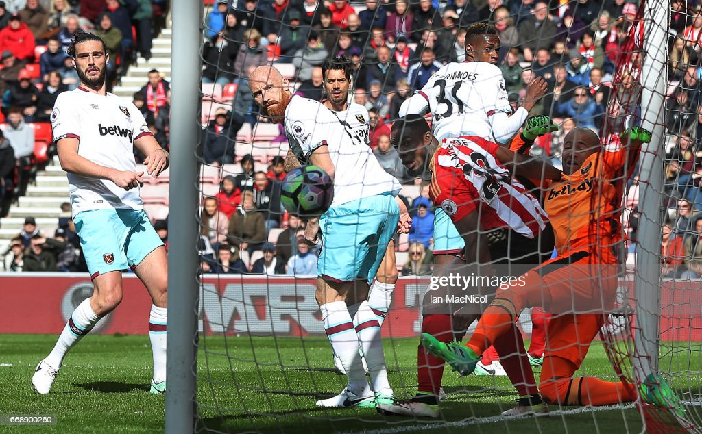 Victor Anichebe of Sunderland challenges Darren Randolph of West Ham United as Wahbi Khazri of Sunderland (not pictured) scores his sides first goal during the Premier League match between Sunderland and West Ham United at Stadium of Light on April 15, 2017 in Sunderland, England.