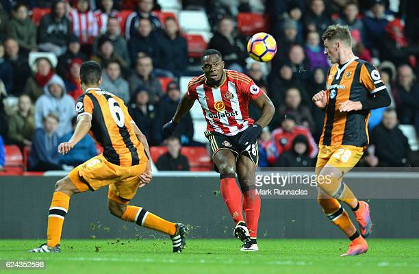 Victor Anichebe of Sunderland crosses the ball while Curtis Davies of Hull City and Josh Tymon of Hull City attempt to block the cross during the...