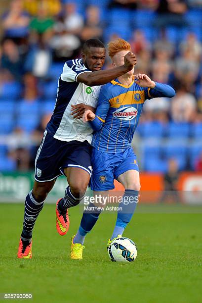 Victor Anichebe of West Bromwich Albion Aaron Wildig of Shrewsbury Town