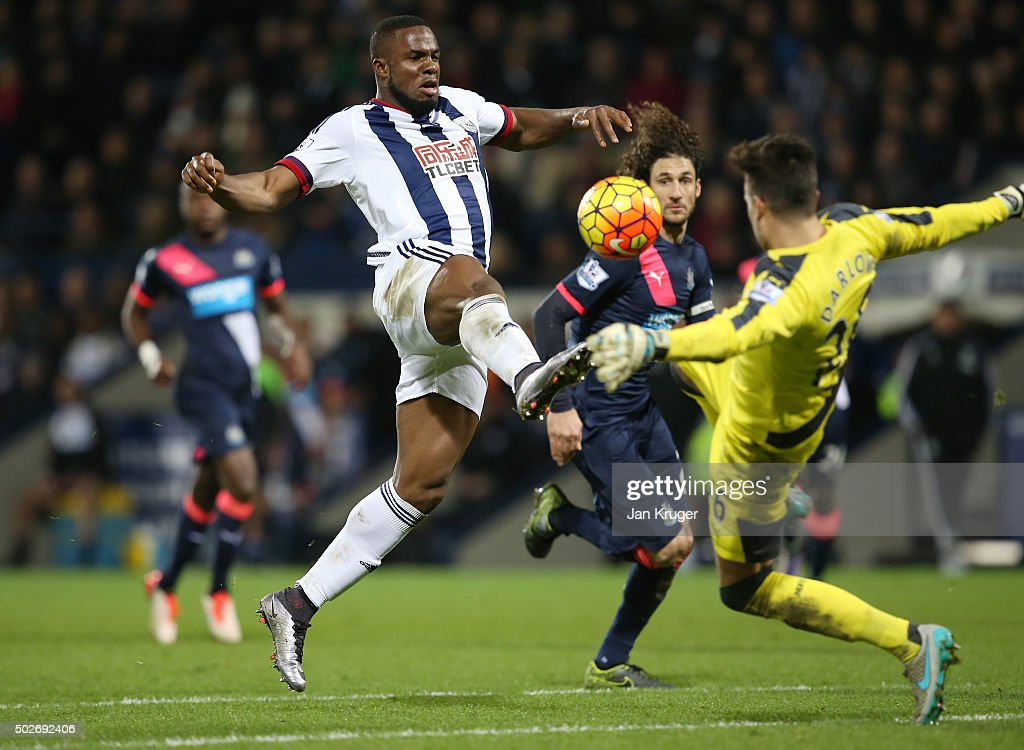 Victor Anichebe of West Bromwich Albion and Karl Darlow of Newcastle United compete for the ball during the Barclays Premier League match between West Bromwich Albion and Newcastle United at The Hawthorns on December 28, 2015 in West Bromwich, England.