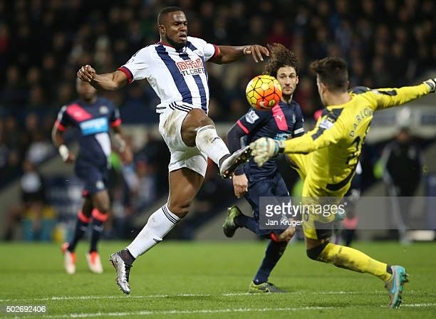 Victor Anichebe of West Bromwich Albion and Karl Darlow of Newcastle United compete for the ball during the Barclays Premier League match between...