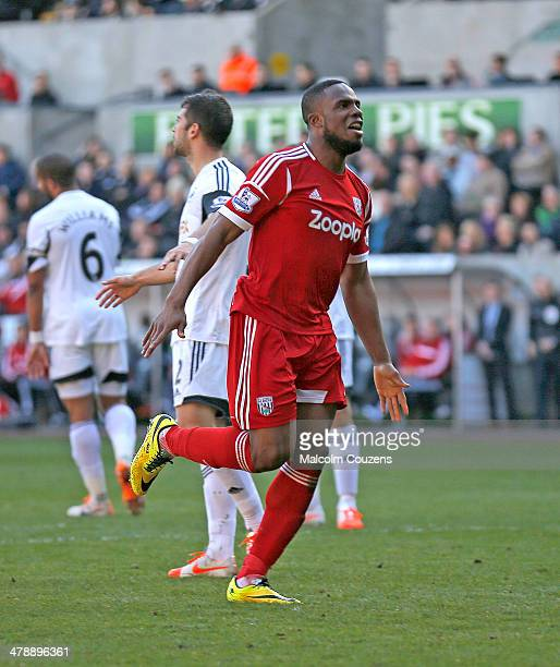 Victor Anichebe of West Bromwich Albion celebrates the goal scored by Stephane Sessegnon during the Barclays Premier League match between Swansea...
