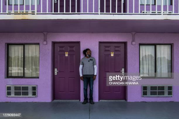 Victor Augustin poses at The Magic Castle Inn in Kissimmee, Florida on October 15, 2020. - Victor Augustin is a cleaner who lost his clients due to...