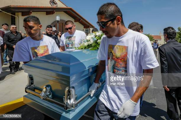 Victor Avalos right father of Anthony Avalos and other family members bring out the casket after funeral services held at Saint Junipero Serra Parish...