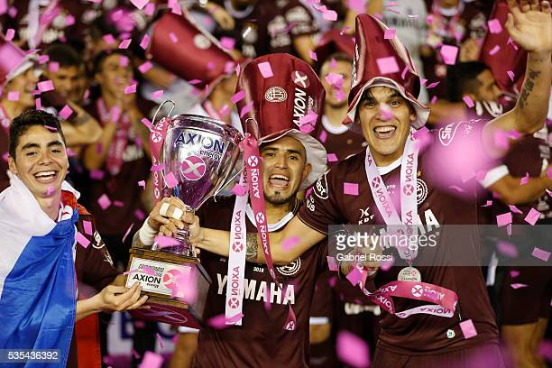 Victor Ayala of Lanus celebrates with the trophy after a final match between San Lorenzo and Lanus as part of Torneo Transicion 2016 at Monumental...
