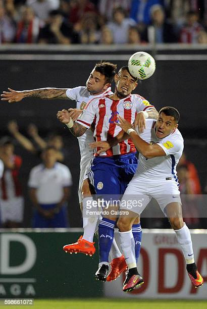 Victor Ayala of Paraguay and Alexis Sanchez of Chile fight for the ball during a match between Paraguay and Chile as part of FIFA 2018 World Cup...