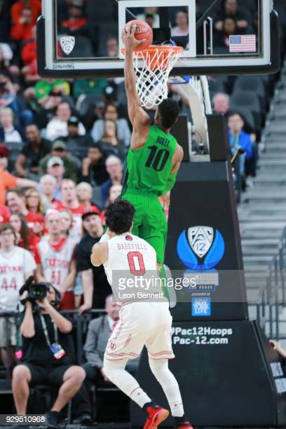 Victor Bailey Jr #10 of the Oregon Ducks dunks the ball against the Utah Utes during a quarterfinal game of the Pac12 basketball tournament at...