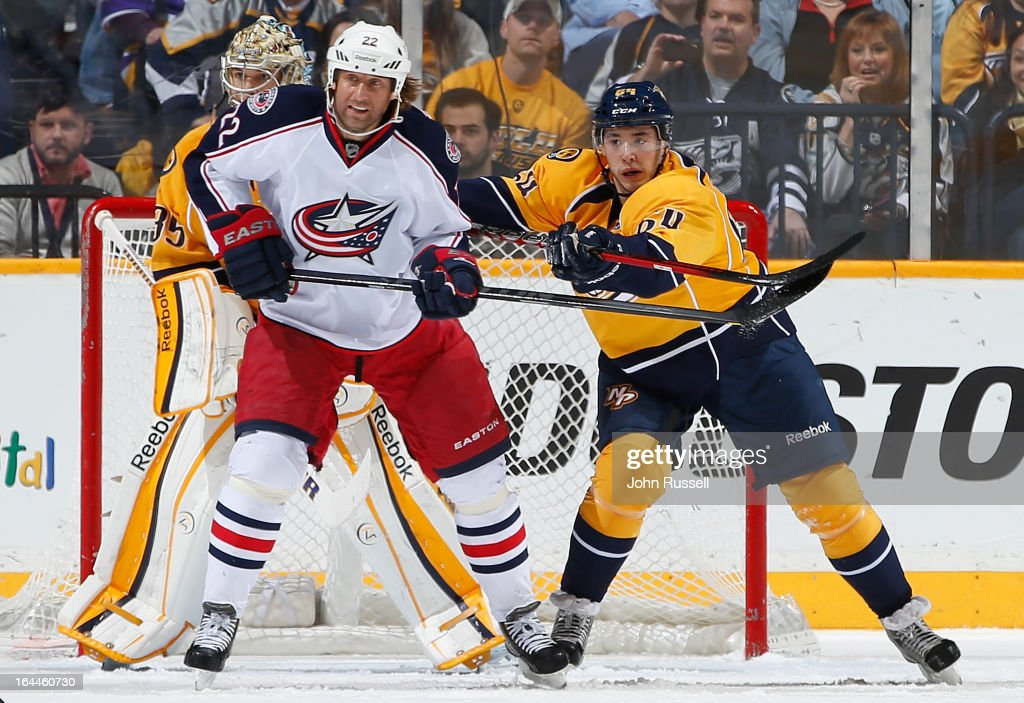 Victor Bartley #64 of the Nashville Predators battles against Vinny Prospal #22 of the Columbus Blue Jackets during an NHL game at the Bridgestone Arena on March 23, 2013 in Nashville, Tennessee.