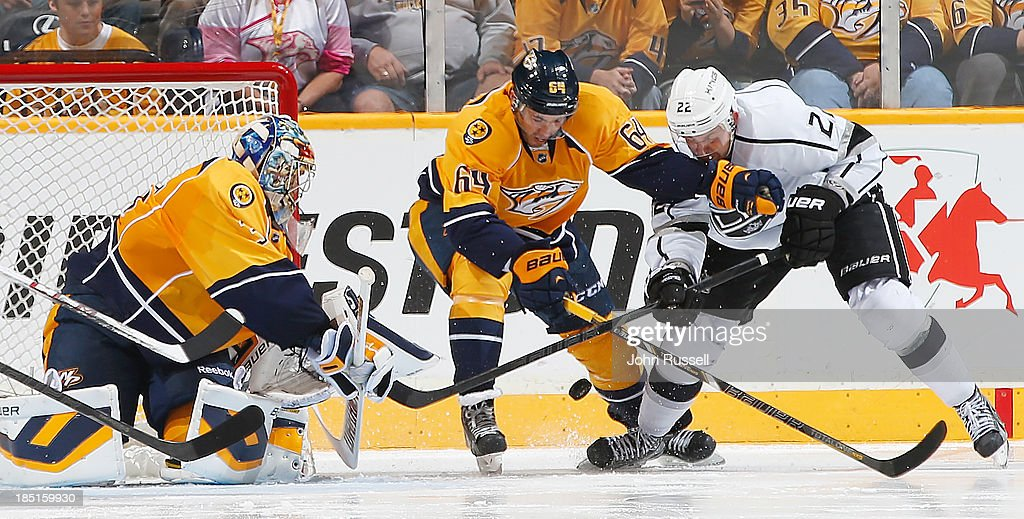 Victor Bartley #64 of the Nashville Predators battles near the net against Trevor Lewis #22 of the Los Angeles Kings at Bridgestone Arena on October 17, 2013 in Nashville, Tennessee.