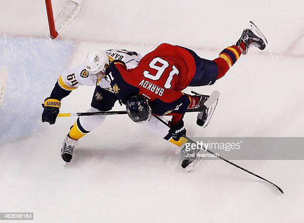 Victor Bartley of the Nashville Predators checks Aleksander Barkov of the Florida Panthers during third period action at the BBT Center on February 8...