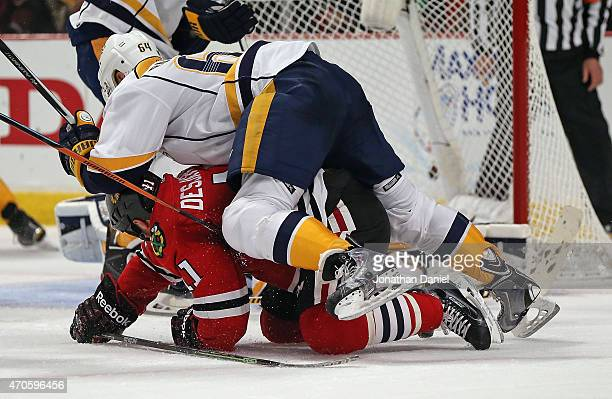 Victor Bartley of the Nashville Predators lands on top of Andrew Desjardins of the Chicago Blackhawks in Game Four of the Western Conference...