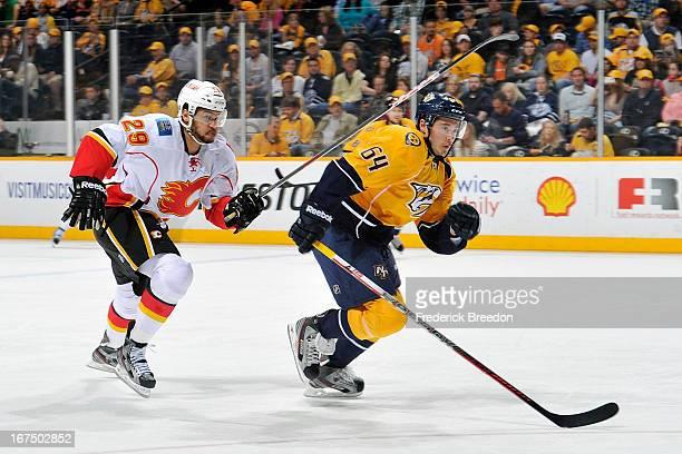 Victor Bartley of the Nashville Predators plays against Akim Aliu of the Calgary Flames at the Bridgestone Arena on April 23 2013 in Nashville...