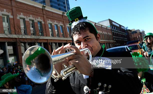 Victor Becerra plays the trumpet with Telemundo during the Annual StPatricks day parade in Denver CO March 14 2015 More than 200000 people were...