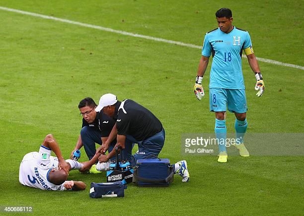 Victor Bernardez of Honduras lies on the field receiving treatment as goalkeeper Noel Valladares looks on during the 2014 FIFA World Cup Brazil Group...
