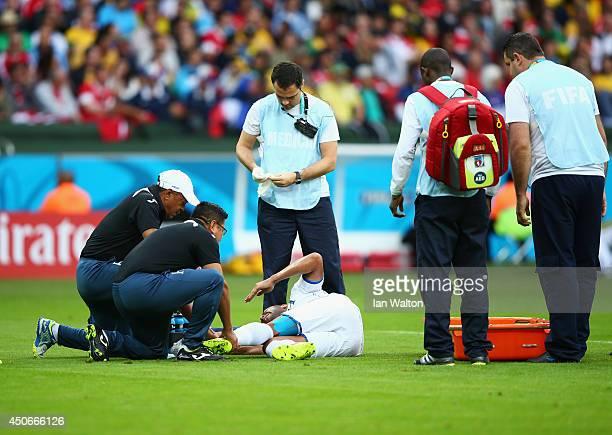 Victor Bernardez of Honduras lies on the field receiving treatment during the 2014 FIFA World Cup Brazil Group E match between France and Honduras at...
