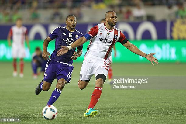 Victor Bernardez of San Jose Earthquakes blocks Julio Baptista of Orlando City SC as he runs toward his goalkeeper during an MLS soccer match between...