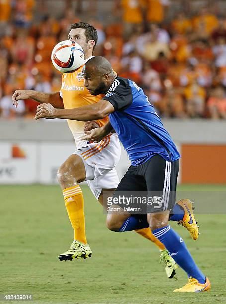 Victor Bernardez of the San Jose Earthquakes battles for the ball with Will Bruin of the Houston Dynamo during their game at BBVA Compass Stadium on...