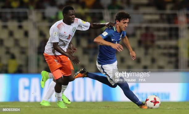 Victor Bobsin of Brazil is challenged by Mahamadou Mahamane of Niger during the FIFA U17 World Cup India 2017 group C match between Niger and Brazil...