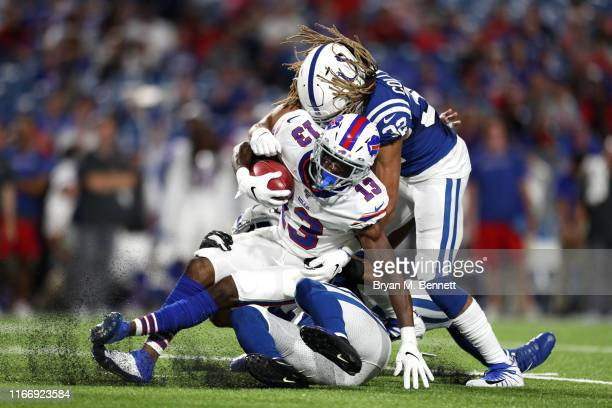 Victor Bolden of the Buffalo Bills is tackled by Jalen Collins of the Indianapolis Colts during a preseason game at New Era Field on August 08, 2019...