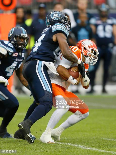 Victor Butler of the Toronto Argonauts sacks Jonathon Jennings of the BC Lions during a CFL game at BMO field on June 30 2017 in Toronto Ontario...