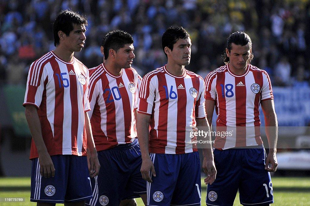 Victor Caceres, Nestor Ortigoza, Cristian Riveros and Haedo Valdez reacts after loosing the Copa America 2011against Uruguay at Antonio Vespucio Liberti Stadium on July 24, 2011 in Buenos Aires, Argentina.