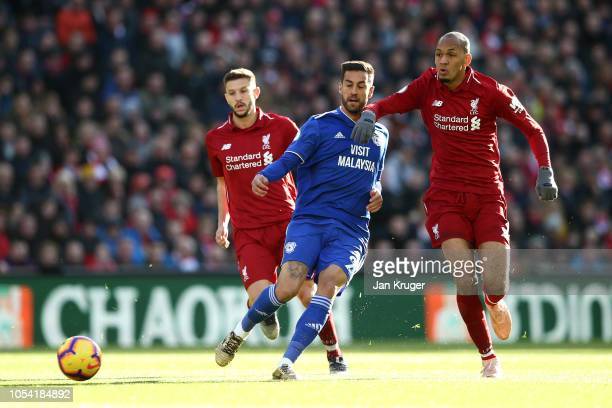 Victor Camarasa of Cardiff City battles for possession with Fabinho of Liverpool during the Premier League match between Liverpool FC and Cardiff...