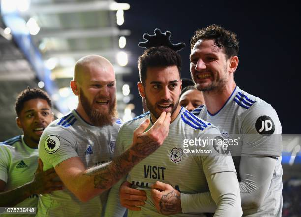 Victor Camarasa of Cardiff City celebrates after scoring his sides first goal during the Premier League match between Leicester City and Cardiff City...