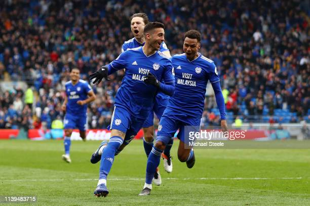 Victor Camarasa of Cardiff City celebrates with his team mates after he score his sides first goal during the Premier League match between Cardiff...