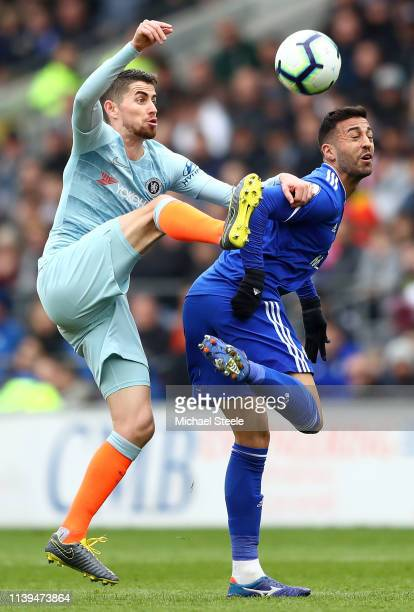 Victor Camarasa of Cardiff City collides with Jorginho of Chelsea during the Premier League match between Cardiff City and Chelsea FC at Cardiff City...
