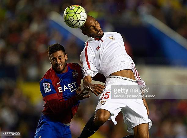 Victor Camarasa of Levante battle for the ball with Steven N'Zonzi of Sevilla during the La Liga match between Levante UD and Sevilla FC at Ciutat de...