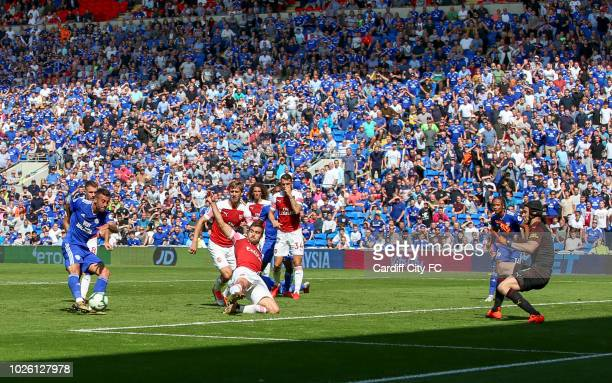 Victor Camarasa scores the first goal for Cardiff City during the Premier League match between Cardiff City and Arsenal FC at Cardiff City Stadium on...