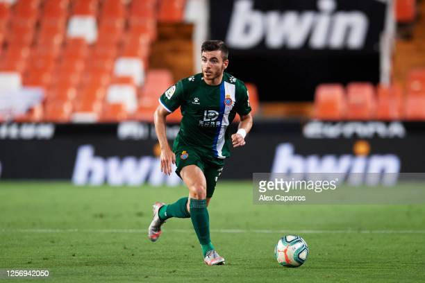 Victor Campuzano of RCD Espanyol runs with the ball during the Liga match between Valencia CF and RCD Espanyol at Estadio Mestalla on July 16 2020 in...