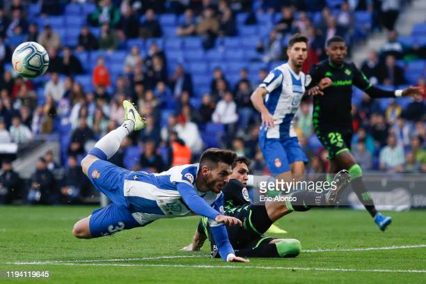 Victor Campuzano of RCD Espanyol stumbles after a challenge against Aissa Mandi of Real Betis Balompie during the La Liga match between RCD Espanyol...
