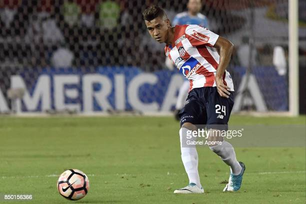 Victor Cantillo of Junior plays the ball during a second leg match between Junior and Cerro Porteño as part of round of 16 of Copa CONMEBOL...