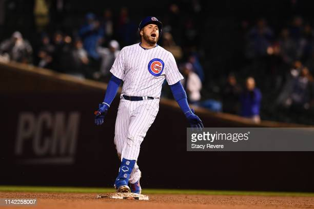 Victor Caratini of the Chicago Cubs reacts after hitting an RBI double against the Pittsburgh Pirates at Wrigley Field on April 11 2019 in Chicago...