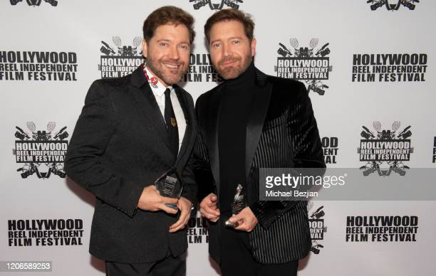 Victor Cardenas and Oliver Cardenas arrive at A Dark Foe Film Premiere on February 15 2020 in Los Angeles California