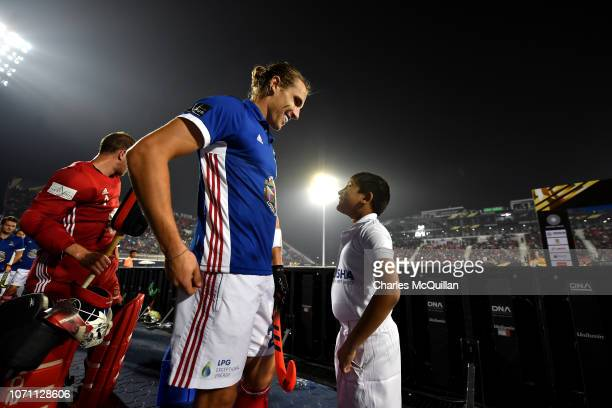 Victor Charlet of France chats with a ball boy ahead of the FIH Men's Hockey World Cup Knockout match between France and China at Kalinga Stadium on...