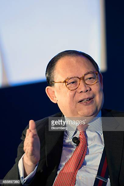 Victor Chu chairman of First Eastern Investment Group gestures as he speaks at the Milken Institute Asia Summit in Singapore on Friday Sept 19 2014...