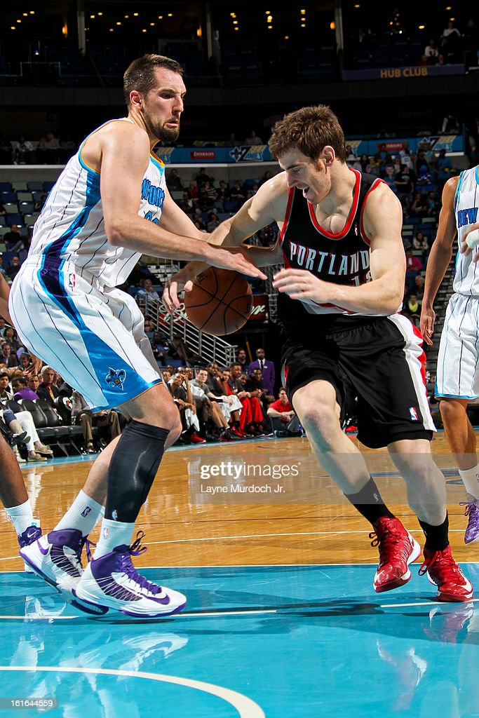 Victor Claver #18 of the Portland Trail Blazers and Ryan Anderson #33 of the New Orleans Hornets battle for a loose ball during their game on February 13, 2013 at the New Orleans Arena in New Orleans, Louisiana.